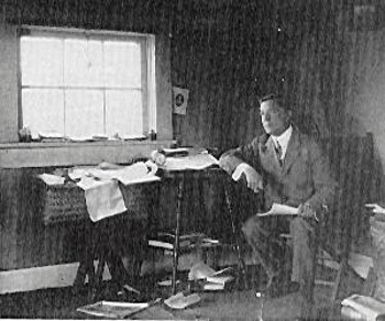 Robert W. Service Working in His Yukon Cabin