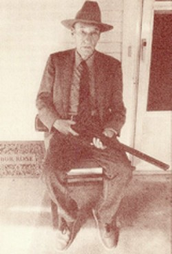 William S. Burroughs with shotgun