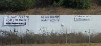 Freeway sign: 'Real soldiers are dying in their hummers.  So you can play soldier in yours.  Ten mpg, two soldiers a day.'